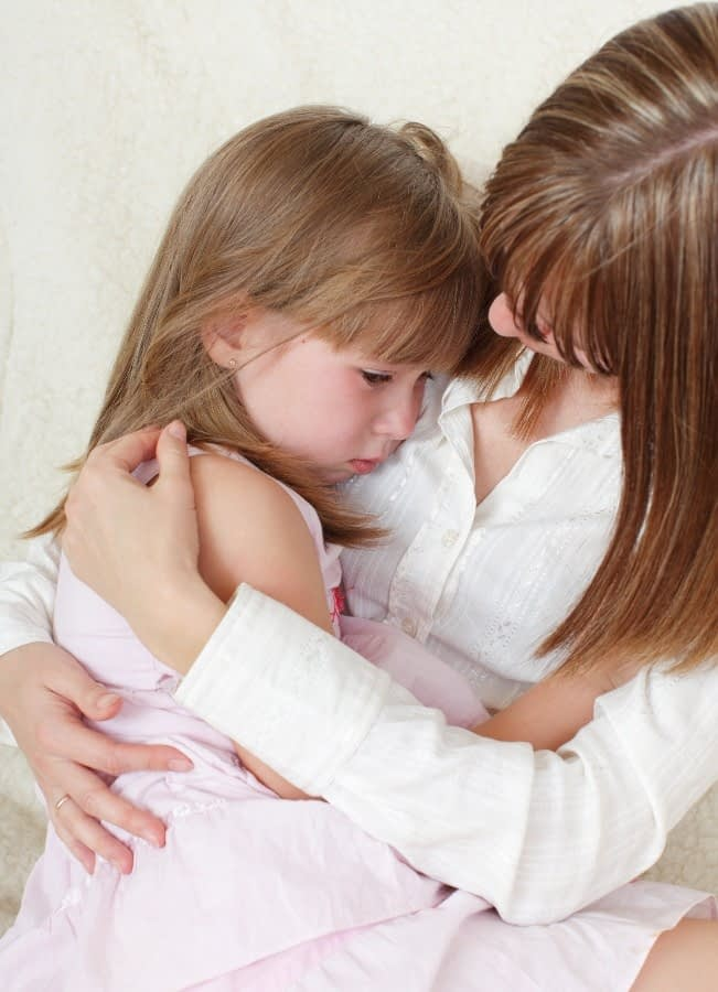A child in her mother's arms showing the power of custody investigations that focus on the child's well being