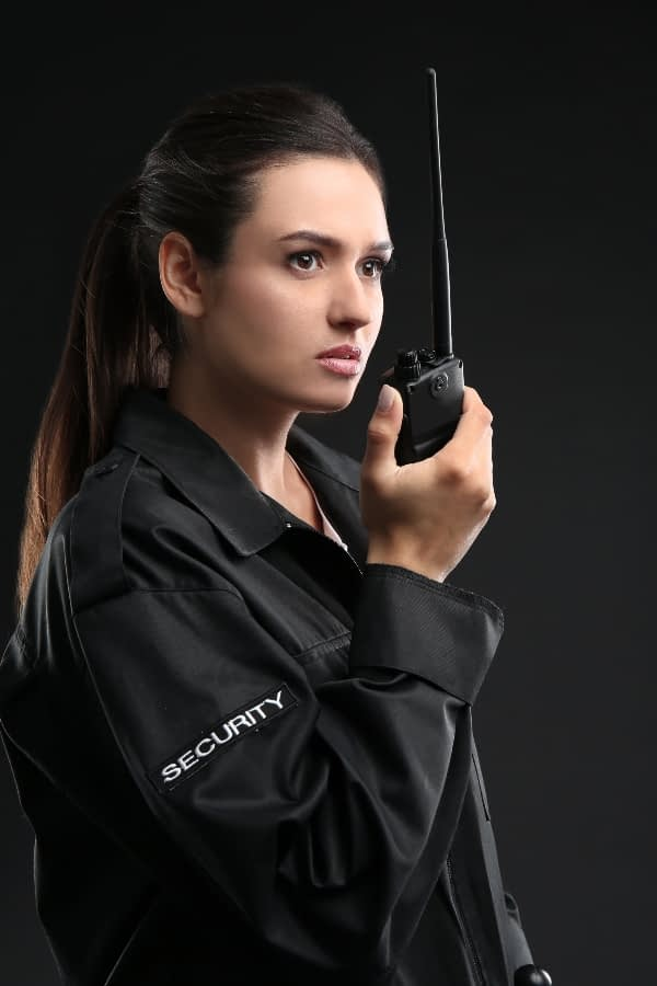 Protection services need to be reliable like this security officer who is ready to call in the team on her radio
