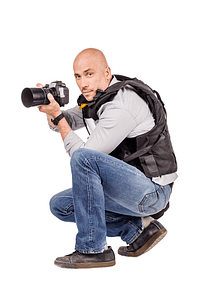 An Infidelity Investigation officer crouched with a camera